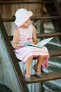 Pretty girl is reading a children's book Royalty Free Stock Photo