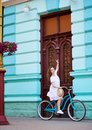 Pretty girl on retro bicycle against vintage door at summer Royalty Free Stock Photo