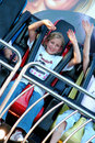 Pretty girl on ride at fun fair Royalty Free Stock Image