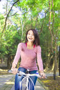 Pretty girl riding a bike and enjoy free time Royalty Free Stock Photo