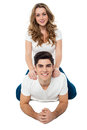 Pretty girl riding on her boyfriend's back Royalty Free Stock Photo
