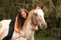 Pretty girl riding a horse without any equipment Royalty Free Stock Photo