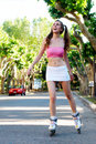 Pretty girl rollerblading Stock Photography