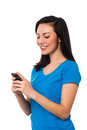 Pretty girl sending text message to her boyfriend young boy friend through cellphone Royalty Free Stock Images
