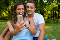 Pretty girl is showing something on smartphone to her boyfriend Stock Photos