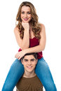 Pretty girl sitting on the shoulders of her boyfriend attractive young s Stock Images