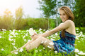 Pretty girl with snowdrop bouquet in forest Royalty Free Stock Photography