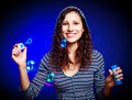 Pretty girl with soap bubbles Stock Photo