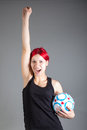 Pretty girl with soccer ball portrait of Stock Photos