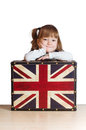 Pretty girl with a suitcase with british flag portrait of little of united kingdom against white background Stock Images