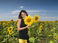 Pretty girl with sunflowers Royalty Free Stock Image
