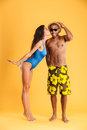 Pretty girl in swimsuit kissing her african boyfriend Royalty Free Stock Photo