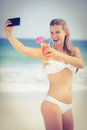 Pretty girl in swimsuit taking a selfie Royalty Free Stock Photo