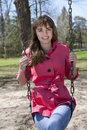 Pretty Girl on Swing in Park Royalty Free Stock Photo