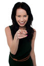 Pretty girl in trendy wear pointing you out gorgeous young black attire Stock Photo