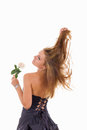 Pretty girl with turn back holding a rose Royalty Free Stock Image