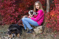 Pretty girl with two chihuahua dogs on the nature Royalty Free Stock Photo
