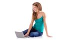Pretty girl using laptop isolated on the white Stock Photography