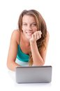 Pretty girl using laptop isolated on the white Stock Images