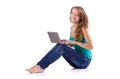 Pretty girl using laptop isolated on the white Stock Photo