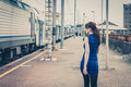 Pretty girl walking along the tracks Royalty Free Stock Photo