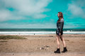 Pretty Girl walking in front of the Beach in California Royalty Free Stock Photo