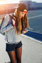 Pretty girl walking outdoors in the street while using busy a smart phone Royalty Free Stock Photo