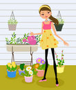 Pretty girl watering the flower Royalty Free Stock Images