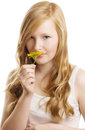 A pretty girl with a yellow flower, isolated Royalty Free Stock Photo