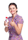Pretty girl young with okay gesture and bottle of water on white background Stock Photo