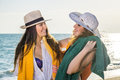 Pretty Girls at the Beach Looking Each Other Royalty Free Stock Photo