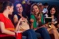 Pretty girls in cinema talking smiling Royalty Free Stock Photo