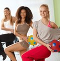 Pretty girls exercising with ball Royalty Free Stock Photo