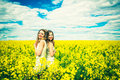 Pretty girls outdoor walking in the field Royalty Free Stock Photo