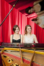 Pretty girls play two part harmony on a piano Royalty Free Stock Photos