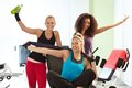 Pretty girls posing at the gym happy Royalty Free Stock Images