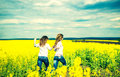 Pretty girls running  in the field in embroidery shirts Royalty Free Stock Photo