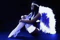 Pretty go-go girl in angel costume Royalty Free Stock Photo