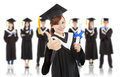 Pretty graduation student thumb up with classmates over white background Royalty Free Stock Photography