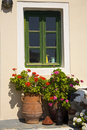 Pretty Greek Window and Flower Pots Royalty Free Stock Photo