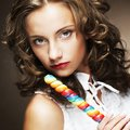 Curly  girl with a lollipop in her hand Royalty Free Stock Photo