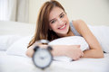 Pretty happy girl waking up in the morning Royalty Free Stock Photo