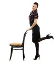 Pretty happy retro woman standing chair isolated white background Stock Photo