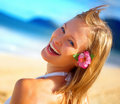 A pretty happy young woman enjoying at a beach Stock Photography
