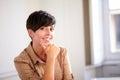 Pretty hispanic businesswoman smiling at you