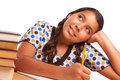 Pretty Hispanic Girl Studying and Daydreaming Royalty Free Stock Photo