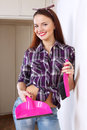 Pretty housewife with pink dustpan and brush Royalty Free Stock Photo