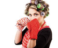 Pretty housewiufe kitchen gloves boxing pose Royalty Free Stock Photography