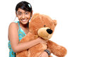 Pretty Indian girl embracing teddy bear Stock Photo