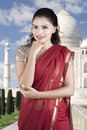Pretty Indian woman wearing red sari clothes Royalty Free Stock Photo